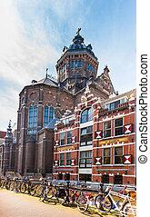 Colorful typical dutch building and Saint Nicholas Church