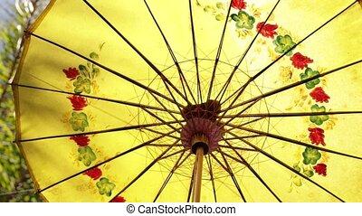 Colorful umbrella closeup background. Bali island