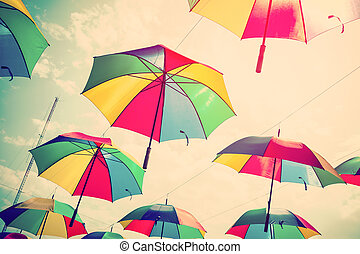 Colorful umbrella street decoration with sunlight. Vintage tone.