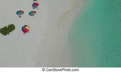 Colorful umbrellas for protection from the sun on the beach....