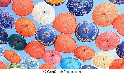 Colorful umbrellas on the blue sky background in Antalya,...
