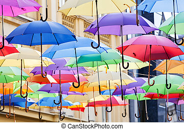 colorful umbrellas - street decoration with colorful open...