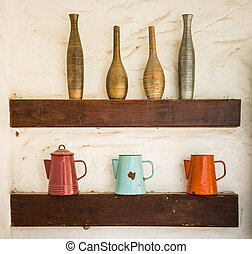 colorful vase baked clay and steel jug put on wood shelf -...
