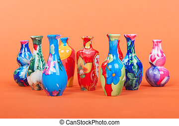 Colorful vases - Colorful chinese vases on orange background