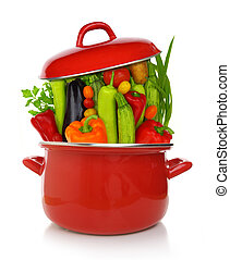 Colorful vegetables in a red cooking pot isolated on white background