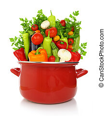 Colorful vegetables in a red cooking pot isolated on white ...