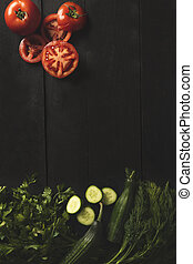 Colorful vegetables on a dark wooden background