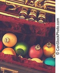 Colorful vintage Christmas baubles with a trumpet