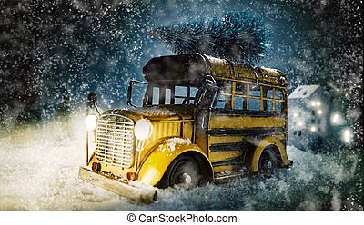 Colorful vintage yellow bus with Christmas tree