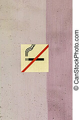 wall structure in stripes with no smoking sign