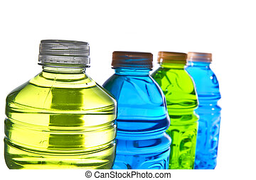 Colorful water bottle tops on white background