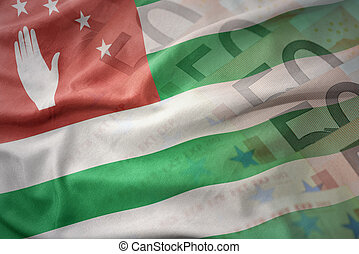 colorful waving national flag of abkhazia on a euro money banknotes background. finance concept