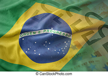 colorful waving national flag of brazil on a euro money banknotes background. finance concept