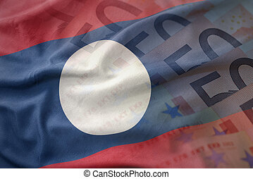 colorful waving national flag of laos on a euro money banknotes background. finance concept