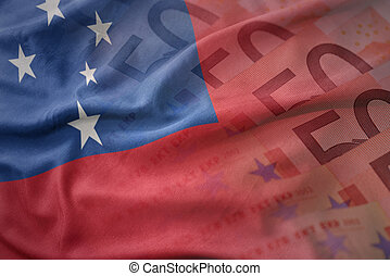 colorful waving national flag of Samoa on a euro money banknotes background. finance concept