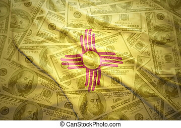 colorful waving new mexico state flag on a american dollar money background