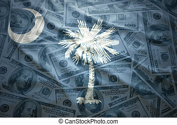 colorful waving south carolina state flag on a american dollar money background