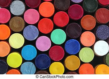 Colorful wax crayon pencils for school art arranged in rows...