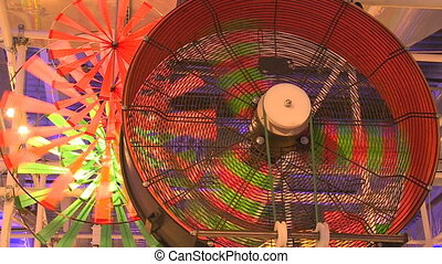 Colorful wheels propellers spin in exhibition. Handheld...