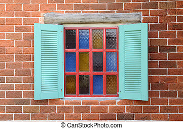 Colorful window on red brick wall