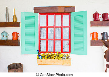 Colorful window with decorating stuffs.