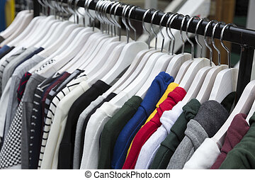 Colorful winter clothes on clothes rack