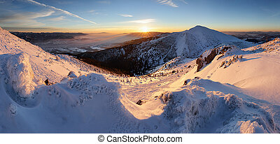 Colorful winter sunrise in mountains, panorama in Slovakia.