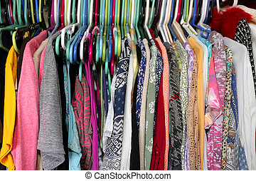 Colorful Woman's Clothing Hanging in a Messy Closet
