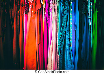 Colorful women dresses at a shop stand.
