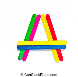 colorful wood ice-cream stick to create A on white background.