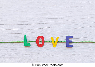 Colorful wooden alphabet and LOVE word on white wooden