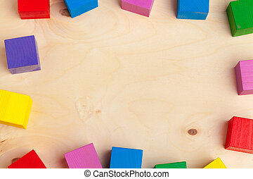 Colorful wooden blocks background, top view. Close up.