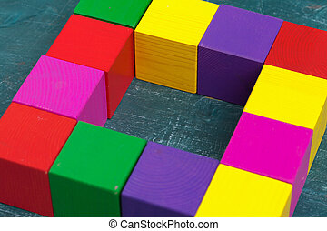 Colorful wooden blocks background, top view. Macro photo. Close up.