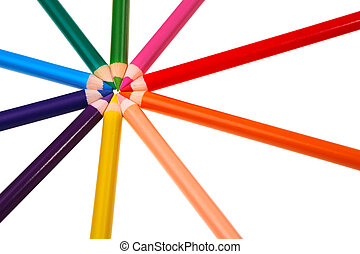 Colorful wooden crayons isolated over white background.