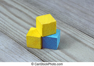 colorful wooden cubes on wood background