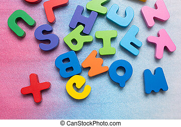 Colorful wooden letters on a white background