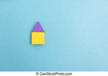 Colorful Wooden toy blocks on blue background