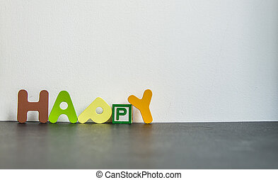Colorful wooden word Happy with white background