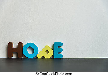 Colorful wooden word hope with white background
