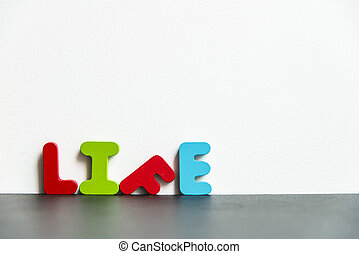 Colorful wooden word life with white background