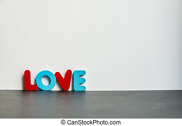 Colorful wooden word Love with white background