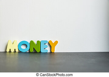 Colorful wooden word Money with white background