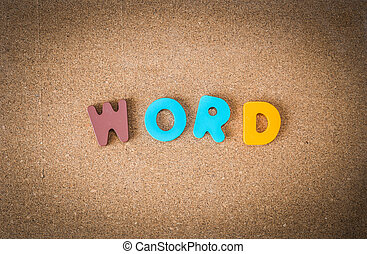 Colorful wooden WORD on cork board