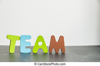 Colorful Wooden word team with white background