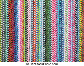 Colorful textile background. Closeup of a vivid knitted scarf.