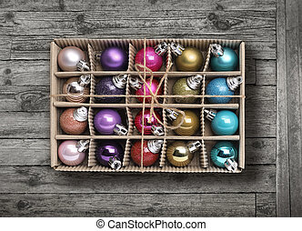 Colorful Xmas balls on old grey wood background