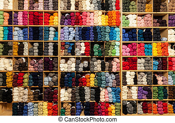 Shelves with yarn in all sorts of colors.