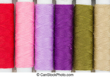 Colorful yarns spool isolated on white