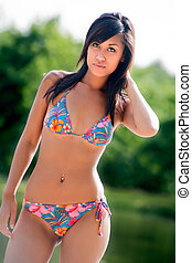Colorfull bikini babe - Young happy asian woman looking ...