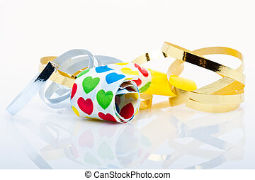noisemakers for a party isolated on white background with air streamers